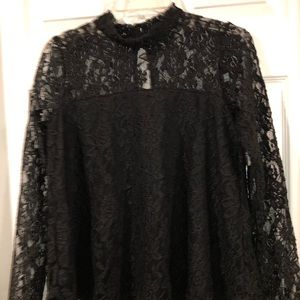 Lace blouse with sheer sleeves and high neck